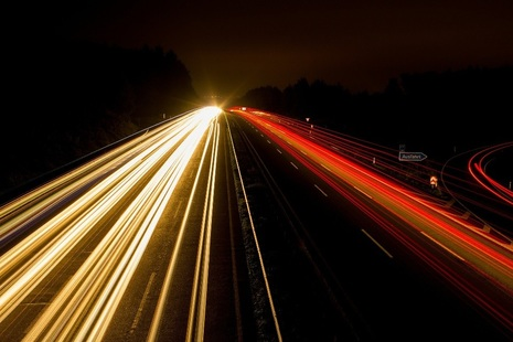 Light-trails from cars on motorway captured using time-lapse photography