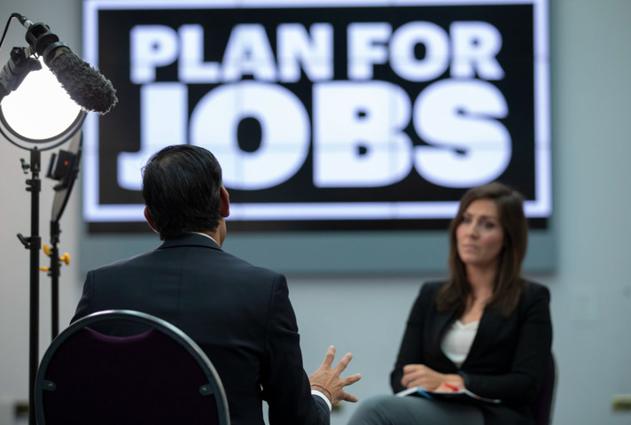 The CX being interviewed by a reporter on Plan for Jobs.