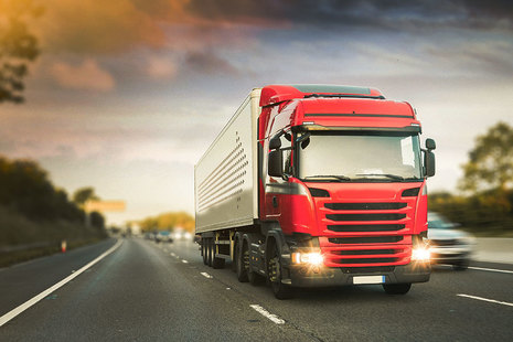 Red lorry on the motorway.