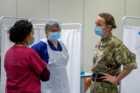 Nurses and member of the military talking