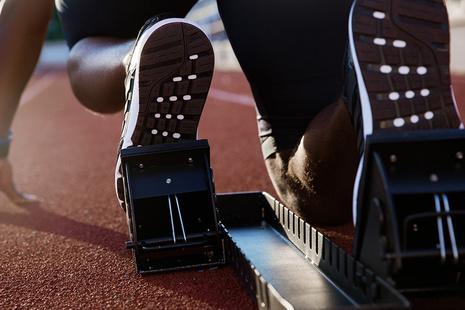 Athlete's feet in starting blocks