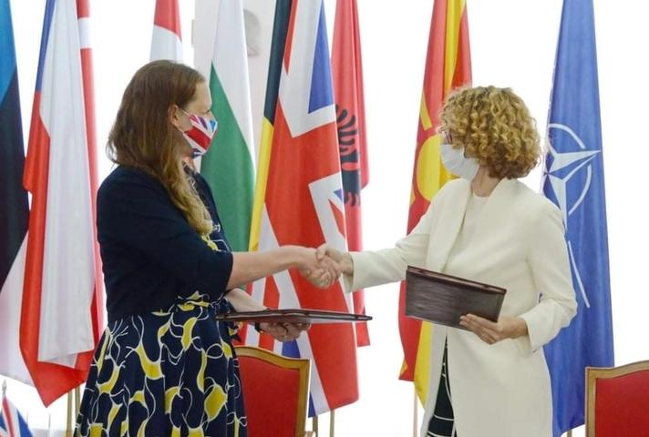 UK Ambassador Rachel Galloway and the Defence Minister for North Macedonia Radmila Shekerinska shake hands