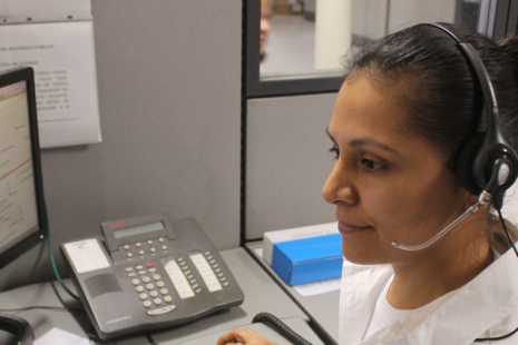 Person wearing a telephone headset answering a call