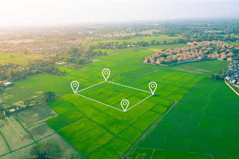 aerial view of green fields overlayed with location icons