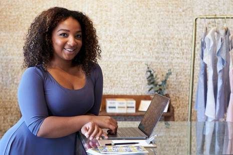 Female small business owner smiling at camera