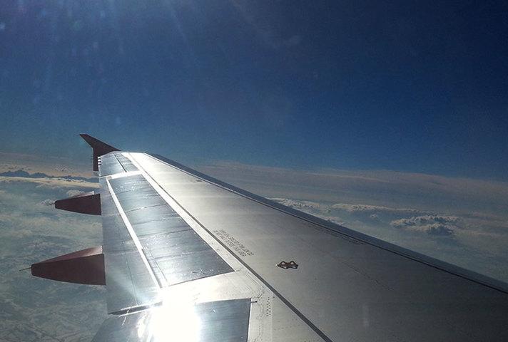 Passenger airplane wing in flight.