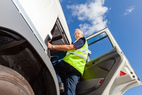 Photo of an HGV driver entering the cab of their vehicle