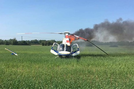 Aircraft on fire in a field