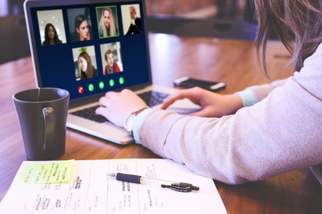 Woman working on laptop in video conference
