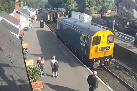 Platform webcam image of light locomotive travelling towards the stationary passenger train (image courtesy of North Yorkshire Moors Railway)