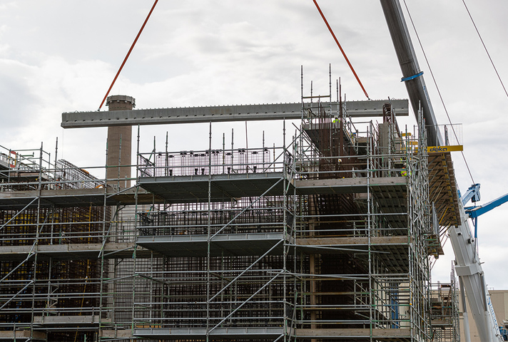 Roof beams being put in place on waste store extension
