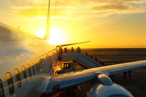 Passengers boarding an airplane,