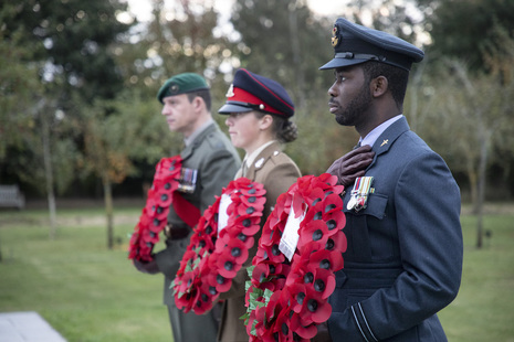 Military personnel with wreaths at the National Memorial Arboretum