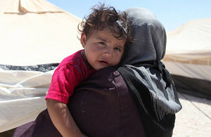 A Syrian refugee woman holds her child in Jordan's Za'atari camp. Photo: UNHCR/Sarah Malkawi