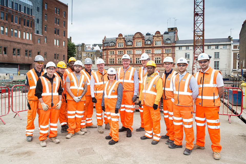 Public health minister Jane Ellison with builders at crossrail