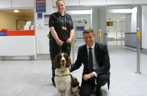 Mark Harper with drug detection dog