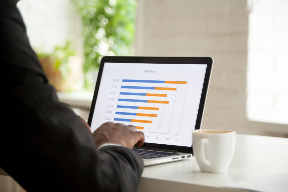 Businessman analysing stats with graph