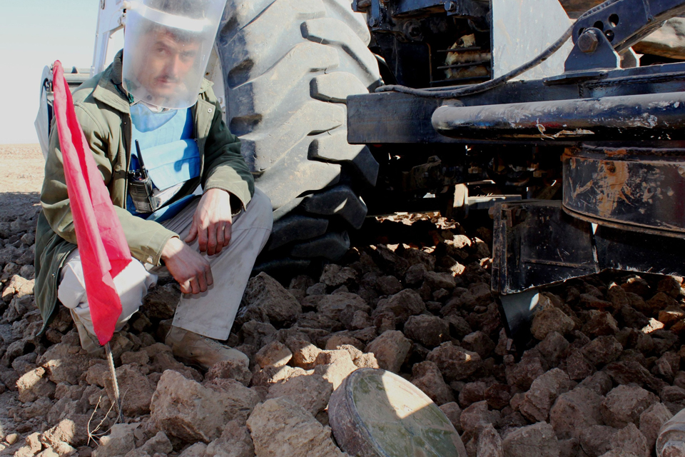 A HALO demining technician inspects a landmine uncovered in Herat, Afghanistan. Picture: Catherine Belfield-Haines/DFID