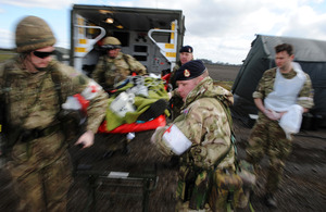 Army medics transfer a simulated casualty from a battlefield ambulance during Exercise Joint Warrior [Picture: Corporal Obi Igbo, Crown copyright]