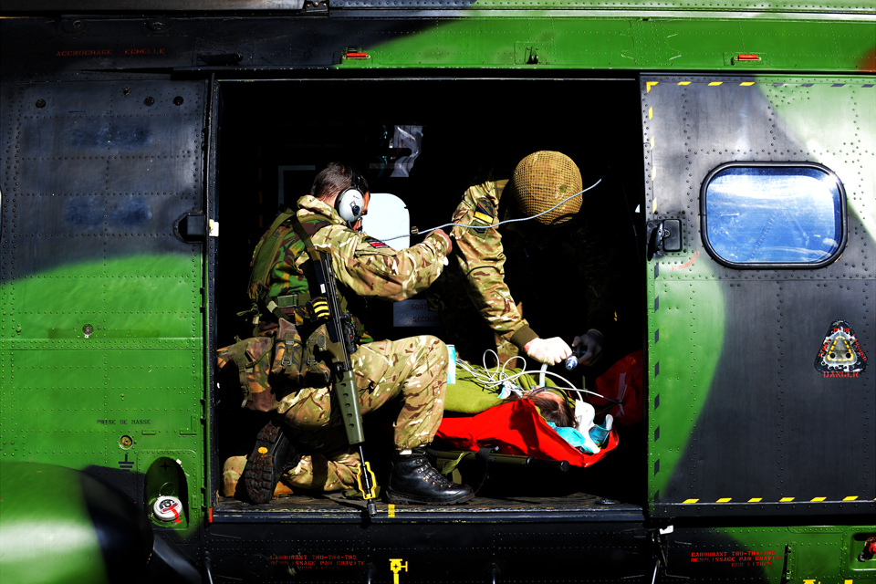 British Army medics tend to a simulated casualty inside a French Puma helicopter