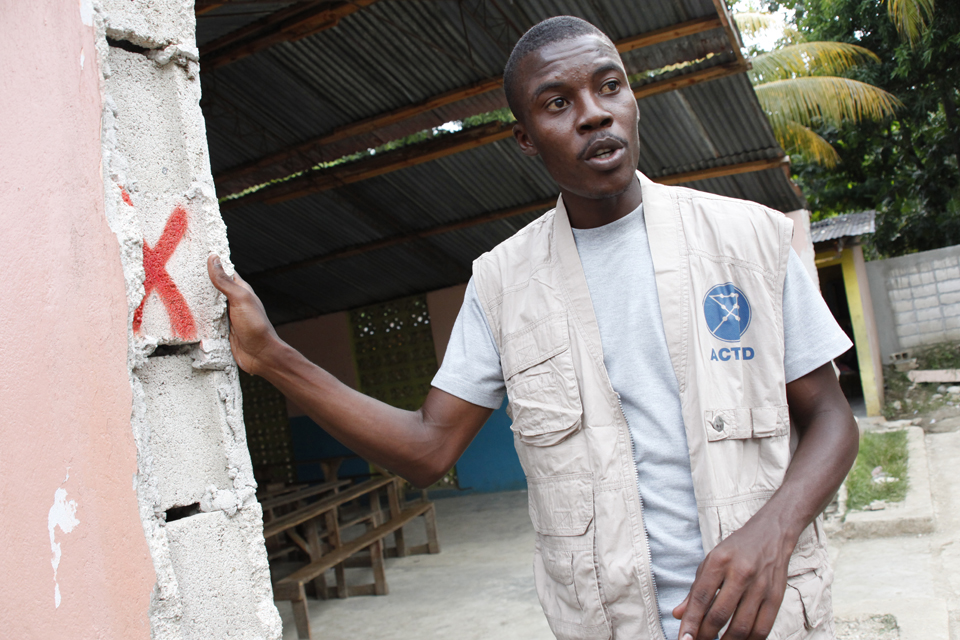 An ACTED engineer assesses an earthquake-damaged building in Leogane. Picture: DFID/Russell Watkins