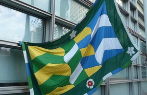 Flag of Cumbria outside Eland House