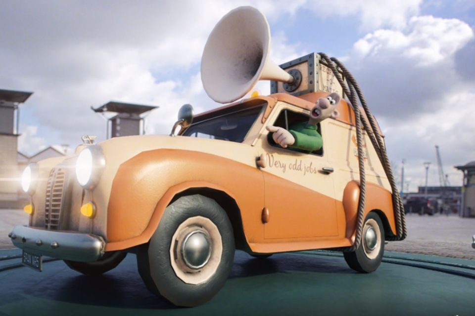 Image of the cartoon character Wallace, from Wallace and Gromit, leaning out of a car.