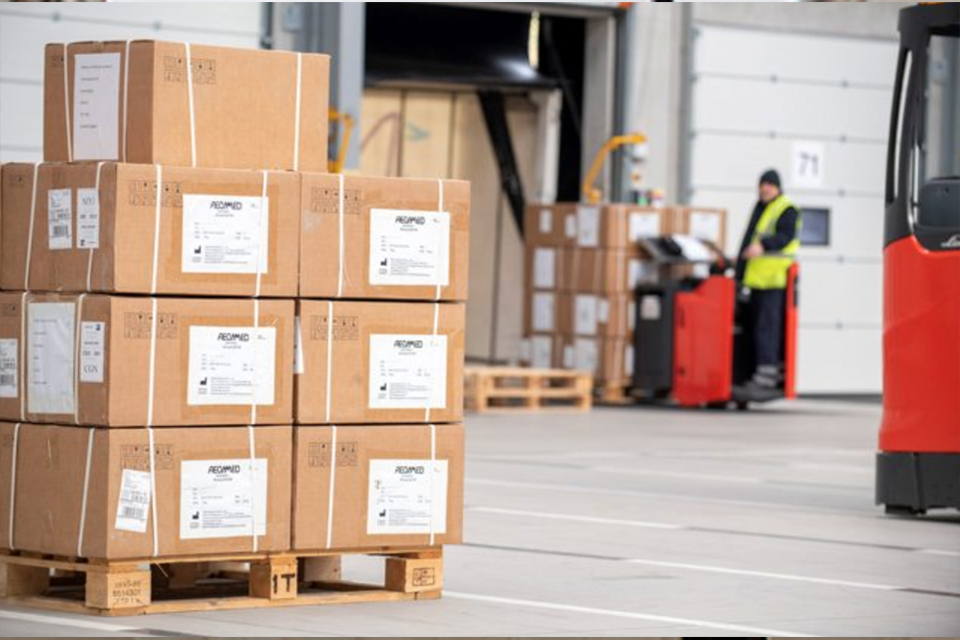 Image depicts a stack of boxes outside MOD Donnington Defence Fulfilment Centre.