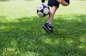 Football at a child's feet
