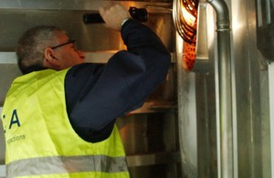 MCA Inspector looking at light fitting