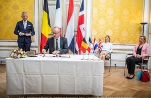 British Ambassador to Belgium, Martin Shearman CVO, signing the treaties