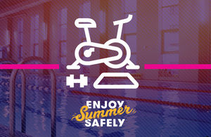 An exercise bike with the words 'enjoy summer safely'