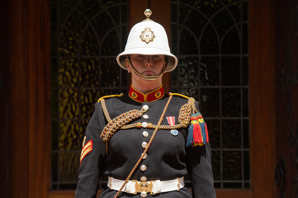 Corporal Kimberley Hare of the Royal Marines is shown standing outside the funeral venue in ceremonial uniform