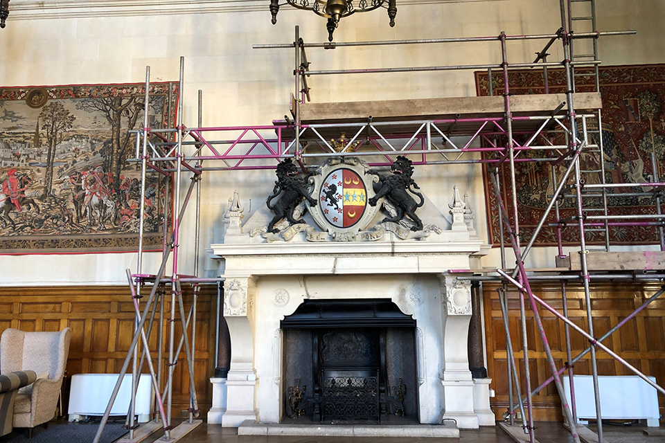 Carrying out repairs in the Great Hall at Thoresby Hall.