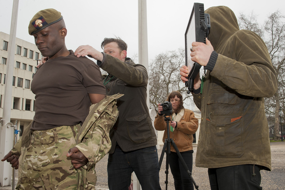 Guardsman Nixon Muga is filmed changing into and out of his uniform