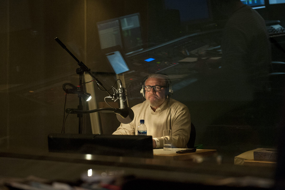 Ray Winstone sits in the recording room