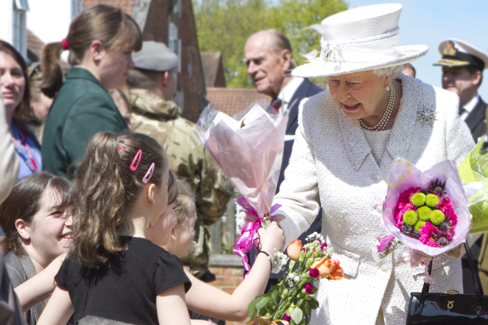 Her Majesty The Queen accepts a posy