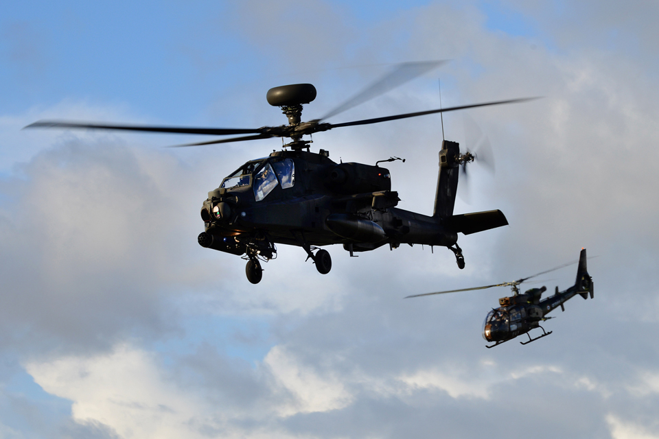 An Apache and a Gazelle helicopter