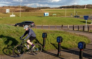 Man on bicycle on route between Birchanger village and Stansted Airport