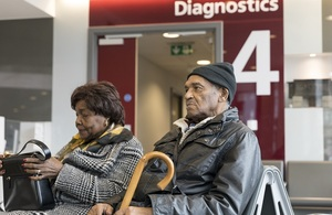 Close-up of elderly couple sitting in diagnostics waiting area