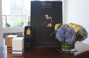 A display of ROJA PARFUMS packaging and promotional material at the British residence.