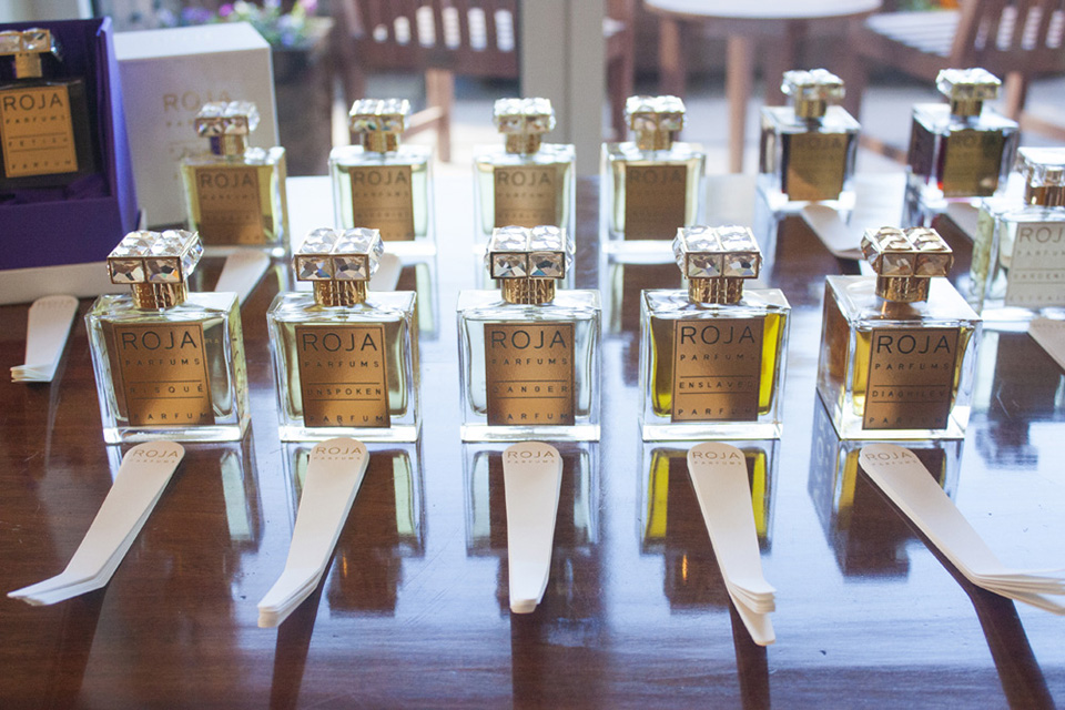 Bottles of ROJA PARFUMS lined up at the British residence.