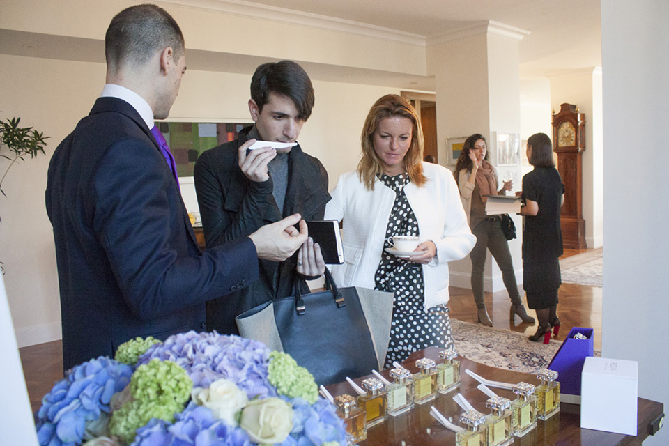 Guests test the various ROJA PARFUMS fragrances at the British residence.