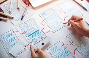 A designer drawing a new design on paper