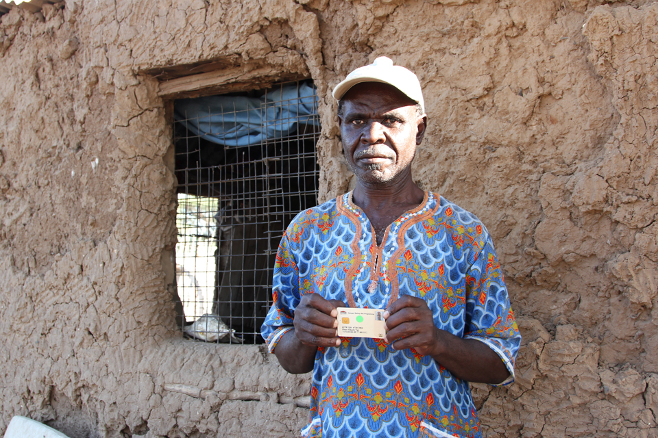 Peter holds the smartcard that ensures he gets the money he's entitled to. Picture: Marisol Grandon/DFID