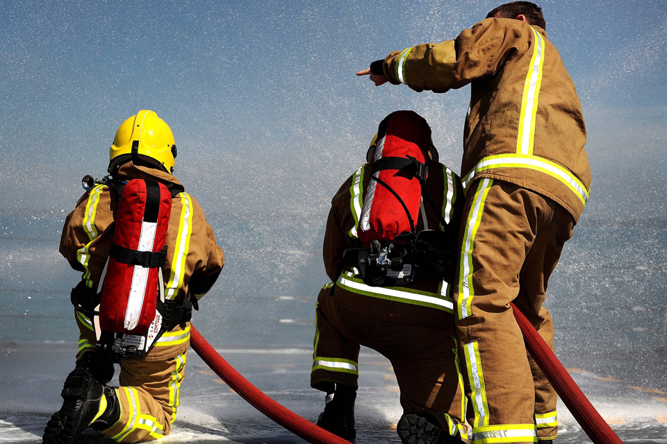 Crew family members have a go at firefighting on board HMS Edinburgh
