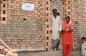 Sabiha Khatoon stands outside her soon-to-be completed new home in Mehar Channa village, in Pakistan's Sindh province. Picture: Vicki Francis/DFID