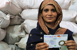 Rahat Amanhuhha holds the voucher that entitles her to vital seeds and fertiliser. Picture: Vicki Francis/DFID