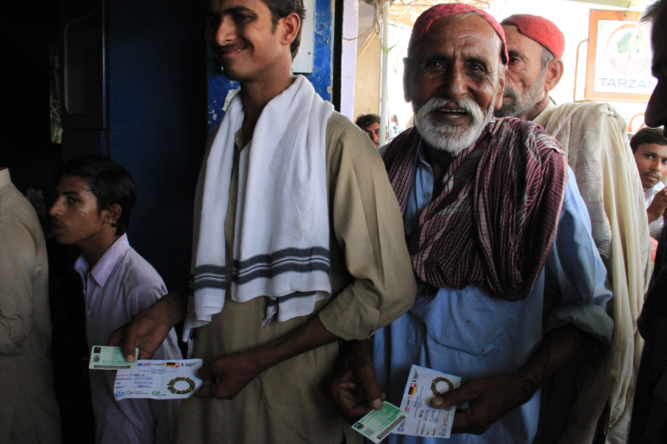 Men stand in line with their vouchers. Picture: Vicki Francis/DFID