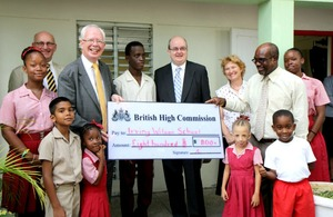 Greening efforts from staff at the British High Commission (BHC) have resulted in the presentation of a cheque for $800 by Lord Wallace of Tankerness to Mr Wilmont Straughn, Principal of the Irving Wilson School.